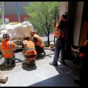 MEI Rigging & Crating Delivers Utah's Jurassic World