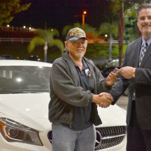 Soboba Casino's Director of Marketing Michael J. Broderick proudly hands the keys of a brand new Mercedes to Vietnam veteran Francis Abergas. (PRNewsFoto/Soboba Casino)