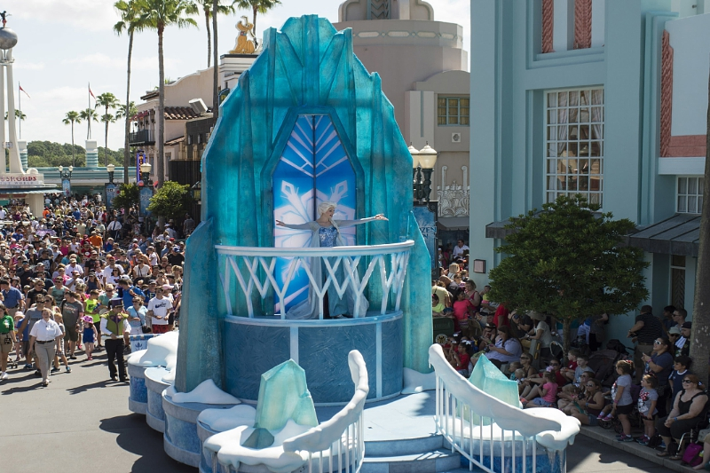 """Twice each day, from June 17 through Sept. 7, Anna, Elsa and Kristoff from Disney's """"Frozen"""" take part in a festive cavalcade throughout Hollywoodland, accompanied by the Royal Arendelle Flag Corps and a flurry of skaters, skiers and ice cutters, along with lovable snowman, Olaf. It's all part of """"Frozen"""" Summer Fun, now at Disney's Hollywood Studios, one of four theme parks at Walt Disney World Resort in Lake Buena Vista, Fla. (Chloe Rice, photographer) (PRNewsFoto/Walt Disney World Resort)"""