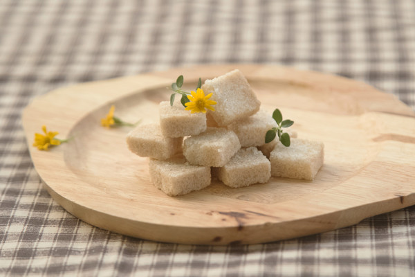 Brown sugar cube on wooden plate