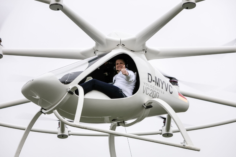 World premiere of manned flights in the Volocopter. e-volo Managing Director Alexander Zosel gives thumbs up to his team for the flight performance of the Volocopter.Location: Airfield in Southern Germany (PRNewsFoto/e-volo)