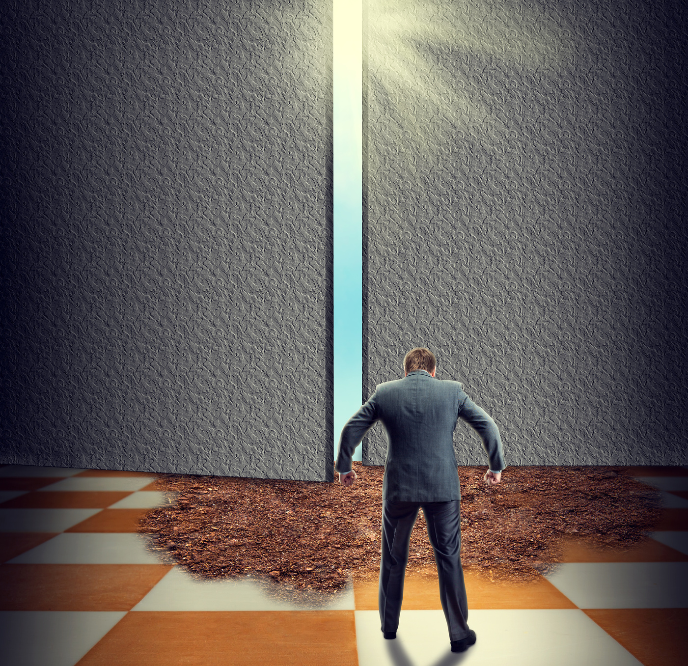 Angry businessman standing on the chess board in front of the door