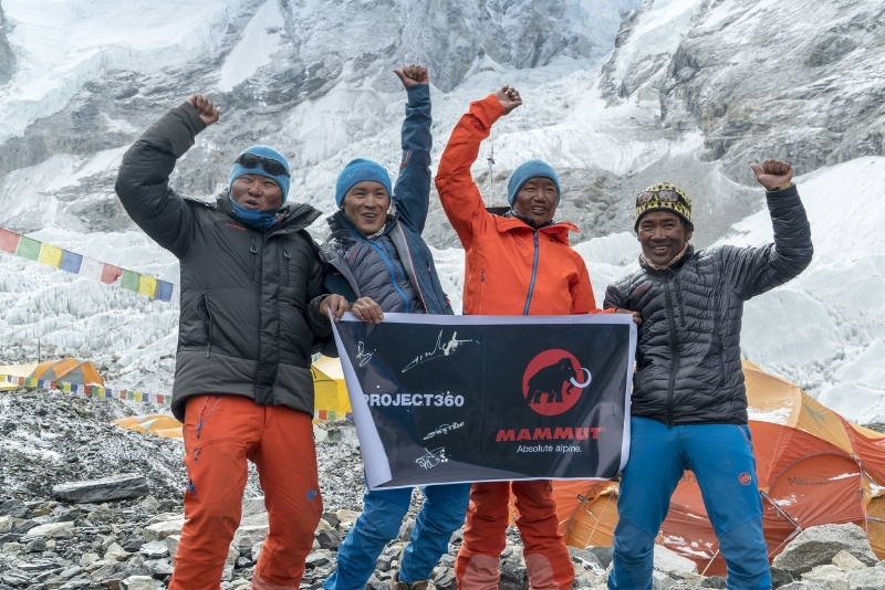 Mammut's #project360 celebrated a new milestone in virtual mountaineering, as the two Nepalese mountain guides Lakpa Sherpa (left) and Pemba Rinji Sherpa (2nd right) with the support of their colleagues Ang Kaji Sherpa (2nd left) and Kusang Sherpa (right) became the first men in the world to document the whole South route to the summit of Mount Everest with a 360-degree camera rig. The four celebrate their successful ascent after returning safely to Everest Basecamp. (PRNewsFoto/Mammut Sports Group AG)